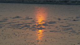 4K Sunrise Reflection In Ocean Surf 3854 stock footage