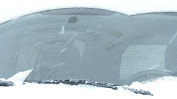 Close-up of windshield wipers brushing away the snow Footage