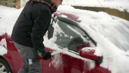 4K Man Clears Snow off Parked Car 3955 Footage