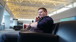 Man Talks on Phone at Airport 3966 Footage
