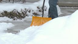 4K Man Shovels Sidewalk 3974 Footage