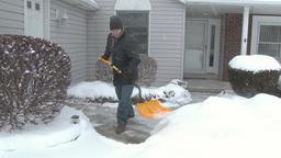 4K Man Shovels Sidewalk 3975 Footage