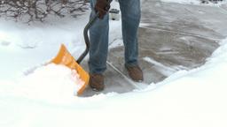 4K Man Shovels Sidewalk 3976 Footage