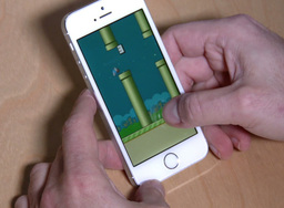 Playing Flappy Bird on an iPhone 5S Footage