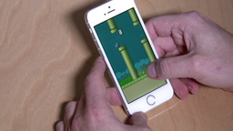 4K Playing Flappy Bird on an iPhone 5S 3986 Footage