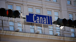 Mardi Gras Beads Hang from Canal Street Sign 4069 Footage