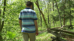 4K A Man Walks Down a Path in the Forest 4371 Footage