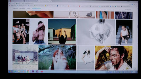 User browsing photography collections on a large screen from 500px website Footage