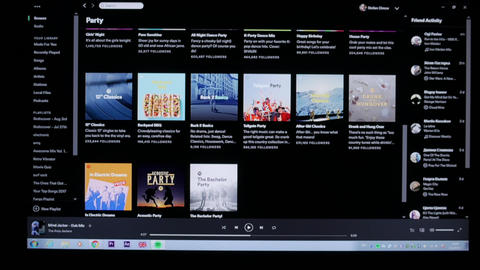 User browsing Spotify music streaming application for suitable music Footage