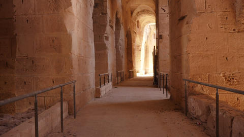 Move along the corridor with arches and light in fortress. Track shot Footage