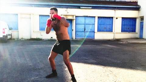 Boxer into a training course - in slow motion - actor arabic / latino Live Action