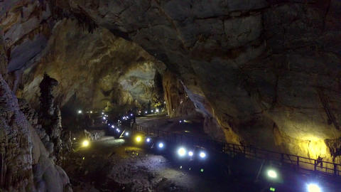 projectors row along geological cave middle part Footage