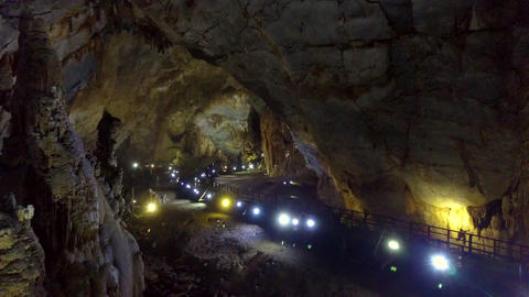 projectors row along geological cave middle part Stock Video Footage