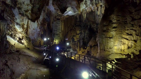 illuminating lamps row by stalagmites structures in cave Footage