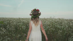 Beauty girl running cross the flower field at sunset Footage