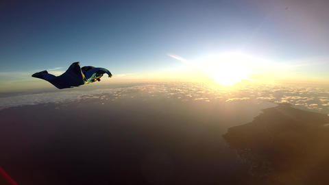 Wingsuit chasing the sunset and follow your dream Footage