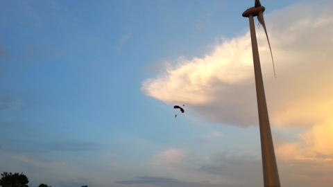 BASE Jumping from a wind turbine at sunset Footage
