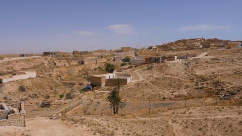 Panoramic view bedouins village in Sahara desert. Berber village in wild desert Footage