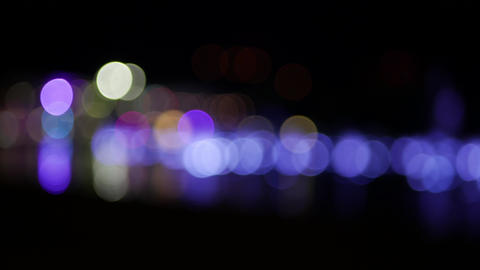 Blinking light color circles at night - abstract background bokeh effect Footage