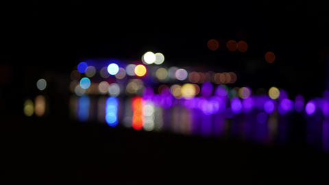 Abstract light blur circles glowing in the night at the city - people outlines ビデオ