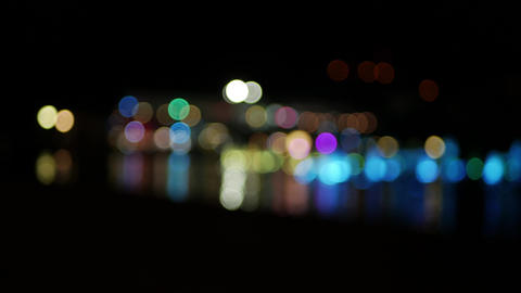 Blur circles blinking in different colors - cityscape bokeh concept footage UHD Live Action