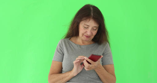 Adult woman using phone on chromakey Footage