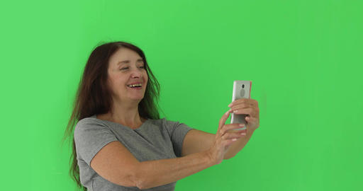 Senior woman taking photo cellphone isolated Footage