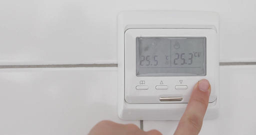 Female hand off a temperature sensor on a white wall Footage