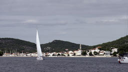 White yachts participate in regatta on background of grey sky in ocean Footage