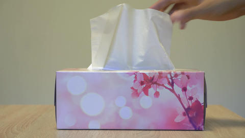 Pulling out tissues from the box Footage