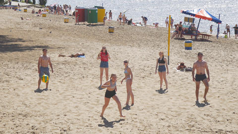 A group of young people playing beach volleybal Footage