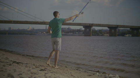 Positive man casting fishing rod while angling Footage