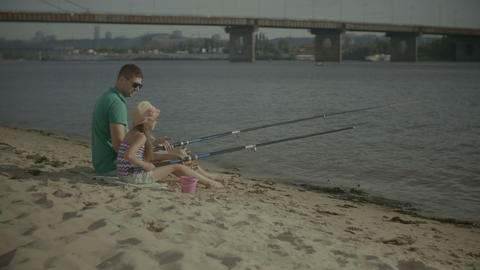 Happy father and daughter fishing together Footage