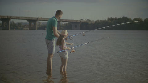 Father and daughter enjoying fishing together Footage