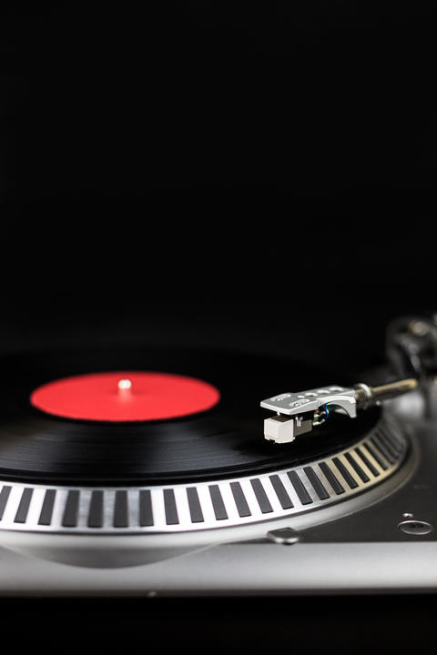Professional party djs turntable on black background. Analog stage audio Photo