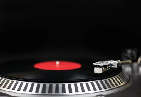 Professional party djs turntable close-up shot. Analog stage audio equipment for フォト