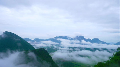 Landscape of mountains and clouds Green tree in the rainy season Footage