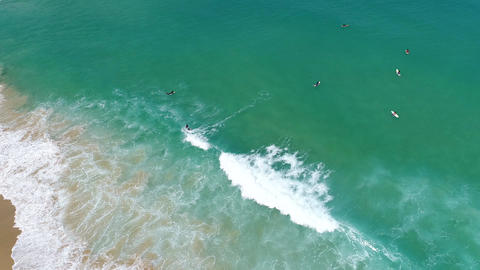 Aerial view of people surfing on the tropical beach Footage