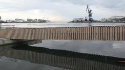 Denmark Scandinavia city of Aarhus wooden footbridge at waterfront promenade Footage