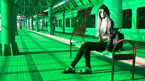 Urban girl in subway railway station sitting on the banch GIF