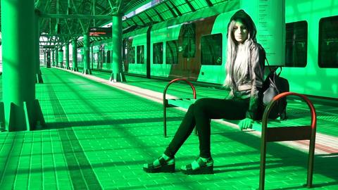 Urban girl in subway railway station sitting on the banch ビデオ