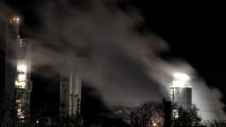 Time lapse of Air pollution being pumped into the air from a factory in a city Footage