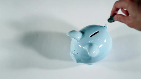Putting coins in piggy bank 영상물