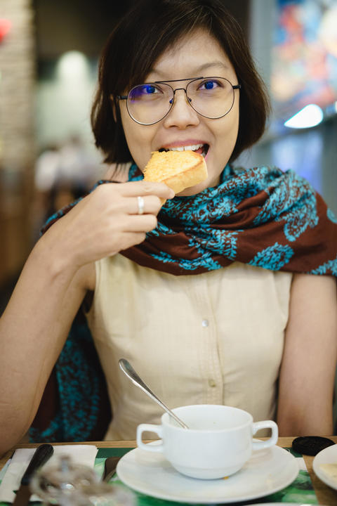 Asian women eating toast bread Photo