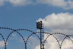 Barbed wire and prison spotlights Fotografía