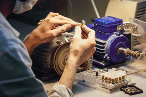 Close-up worker making details in shop Photo
