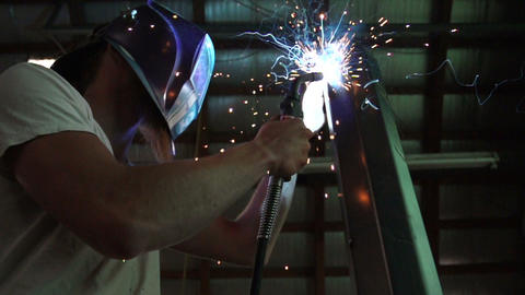 Man Welding Metal Live Action