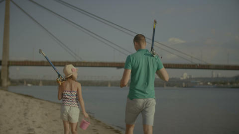Father and daughter going for fishing together Footage