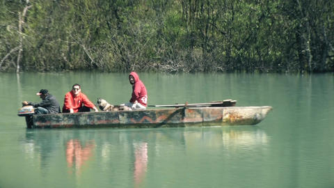 People on a Small Boat Fishing in a River Footage