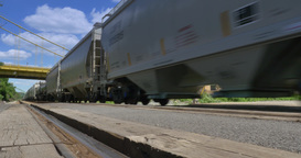 4K Freight Train Passes By Low Angle with Sound Footage